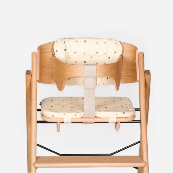 KAOS kussenset compleet ecru in stoel met beugel